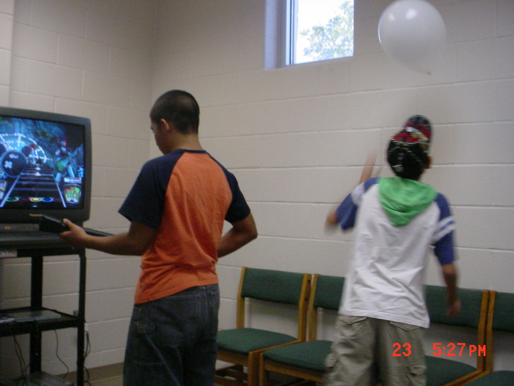 Teens playing games and challenging their friends at the Lark Branch Library.